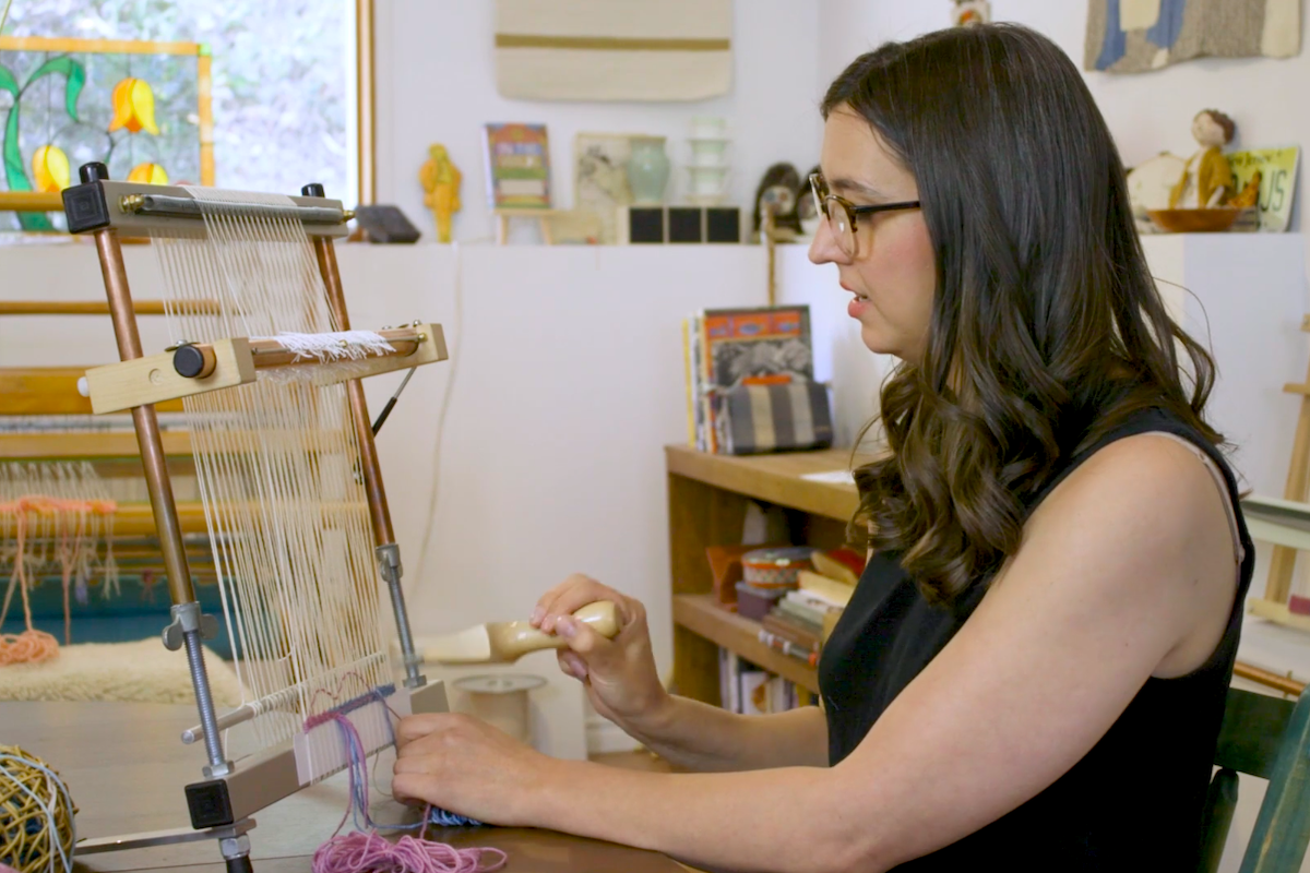 Janna Maria Vallee demonstrating weaving at the School of SweetGeorgia online tapestry course