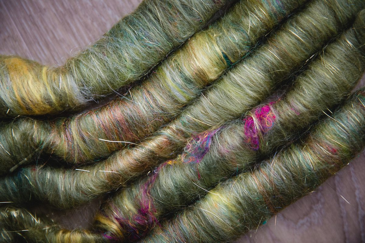 Spinning fibre rolags by Debbie Held